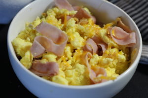 Delicious and quick ham, egg and cheese breakfast scramble to get your day started off right.