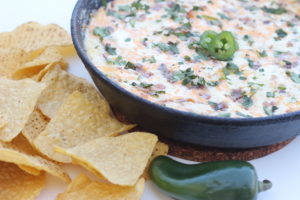 Baked Jalapeño Popper Dip with Bacon perfect for hanging out or catching the game. It's the best type of comfort food, warm, flavorful and easy to make.
