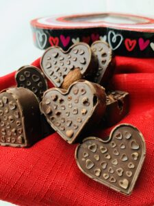 Keto-Friendly Chocolate Covered Almond Hearts are the perfect Valentine's Day treat to make with your family. It's only two ingredients so even your littlest little ones can join in on the family fun.