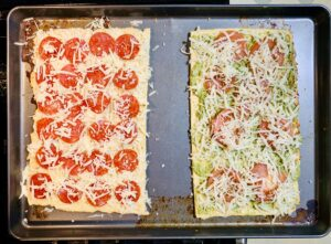 A Keto Chicken Crust Pizza recipe that's only 4 ingredients and a great foundation for a super fun family pizza night. Everyone can add the toppings they love to make a pizza that's perfect for them.